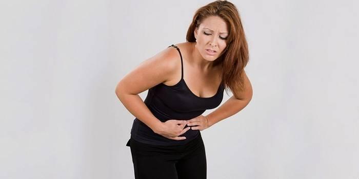 Симптом полипов в желудке - боль в области живота